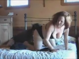 mature woman jerking two dicks