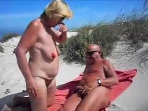 oiling boobs beach video