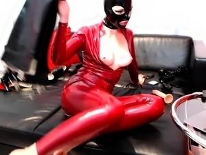 blonde in black latex stripping